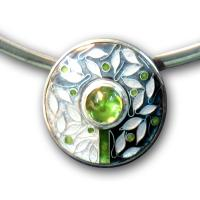 <p>Pendant<br />2010<br />30mm x 30mm<br />Stg and fine silver, cloisonn&eacute; enamel, peridot, sterling silver neckring<br />I can also make this pendant with garnet, pink tourmaline or amethyst in enamel colours to compliment the gemstone</p>