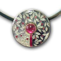 <p>Pendant<br />2010<br />30mm x 30mm<br />Stg and fine silver, cloisonn&eacute; enamel, pink tourmaline, sterling silver neckring<br />I can also make this pendant with garnet, amethyst or peridot in enamel colours to compliment the gemstone</p>